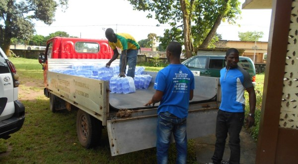 Distributing fresh water to families [Photo credit: Moses Khanu]