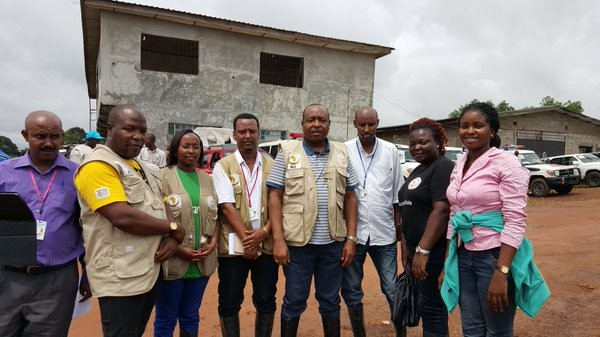 Dr. Djoudalbaye Benjamin (center) and members of ASEOWA in Liberia during the Ebola outbreak.