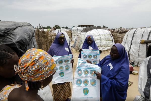 Community volunteers go door-to-door to explain the importance of hand-washing. Credit: UNICEF